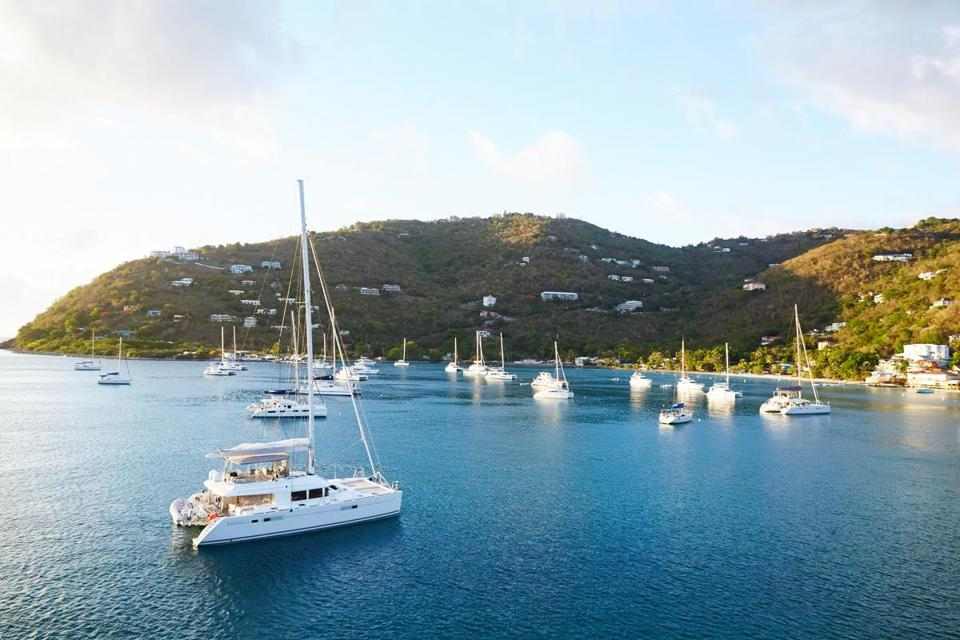 "Virgin Island Sailing School's catamaran ""Silver Lining"" moored in Cane Garden Bay in Tortola."