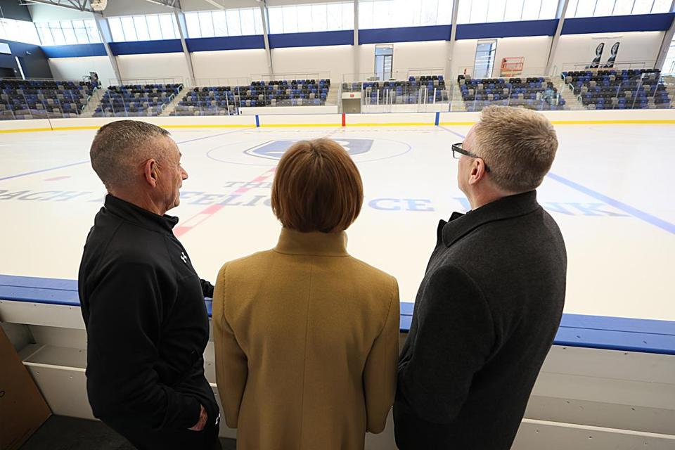 From left: Bentley University Athletic Director Bob DeFelice, President Gloria Larson, and Dean of Students Andrew Shepardson admire the $45 million Bentley Arena, which officially opens Feb. 15.