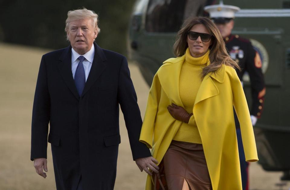 President Trump and Melania Trump walked across the South Lawn after arriving at the White House after a trip to Ohio on Monday.