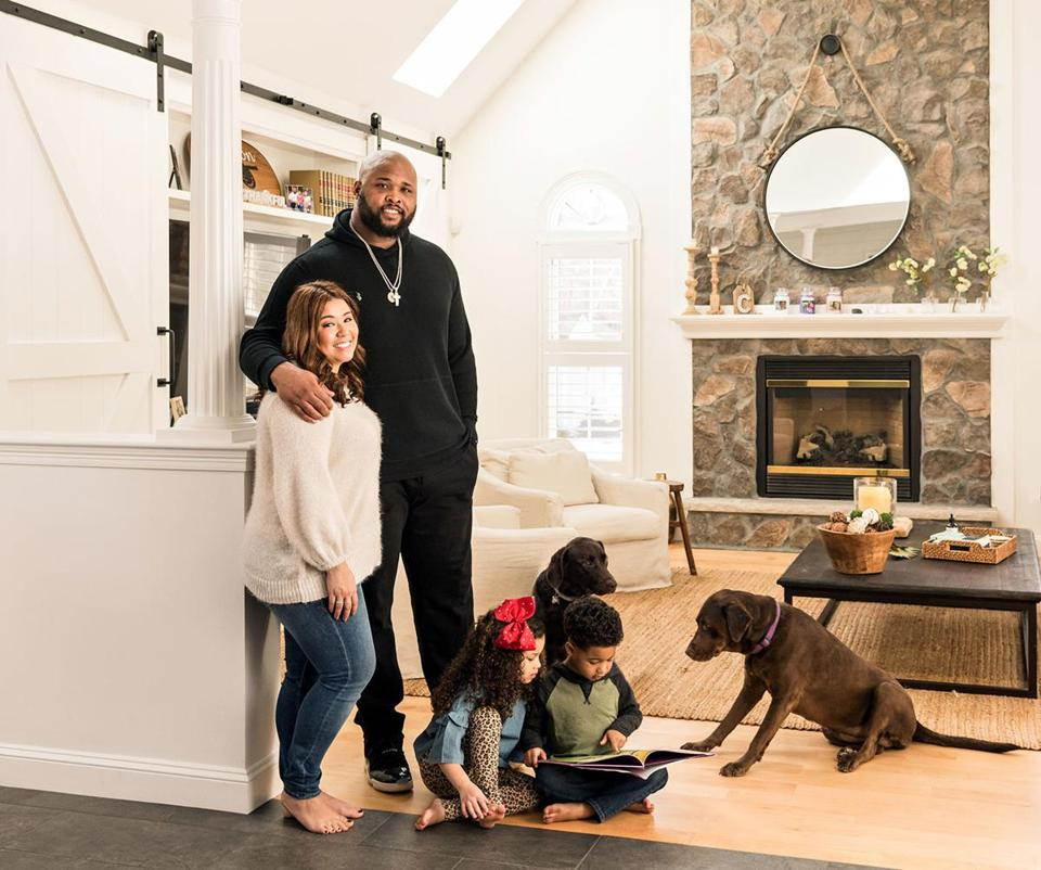 Marcus, Alyssa, Mady, and M.J. Cannon put down roots in this five-bedroom house in Wrentham, down the road from Gillette Stadium.