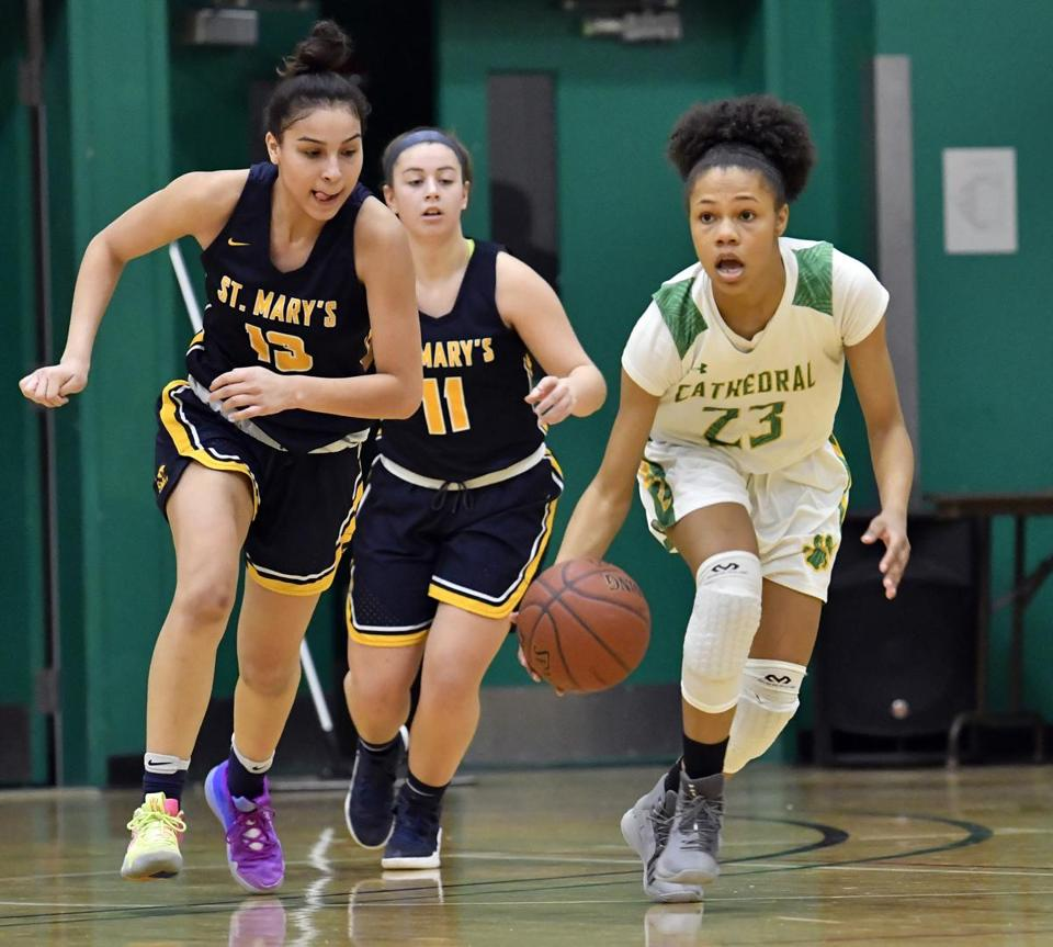 Cathedral's Ariana Vanderhoop right, is pursued by St. Mary's players, from left, Pamela Gonzalez, and Ashley Sullivan, during their matchup at Cathedral in a Catholic Central girls' game. Josh Reynolds for The Boston Globe (Sports, petrini)
