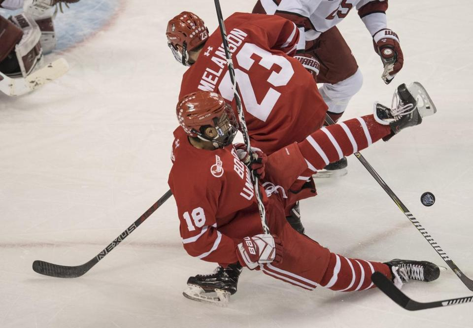 BU's Jordan Greenway (18) collides with teammate Drew Melanson during the second Beanpot semifinal.