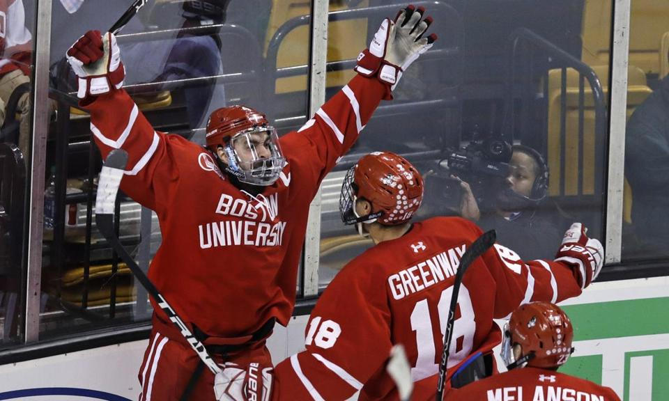 Boston University defenseman Brandon Hickey, left, celebrates with forward Jordan Greenway (18) after his goal off Harvard goaltender Merrick Madsen (31) during the third period of the first round of the Beanpot hockey tournament in Boston, Monday, Feb. 5, 2018. (AP Photo/Charles Krupa)