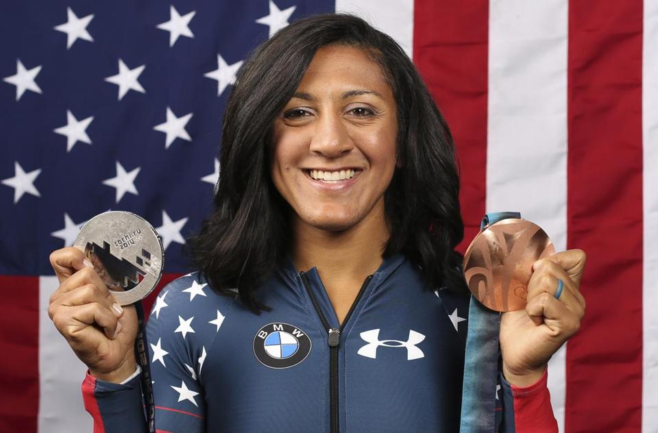 FILE - In this Sept. 25, 2017, file photo, United States bobsledder Elana Meyers Taylor poses for a portrait with her Olympic medals at the 2017 Team USA Media Summit in Park City, Utah. The progression is obvious. Bronze in 2010. Silver in 2014. That would mean Meyers Taylor has one Olympic stone left unturned, and after a very challenging year the U.S. women's bobsledder is starting her final preparations to win the gold that slipped away at the Sochi Games four years ago. (AP Photo/Rick Bowmer, File)
