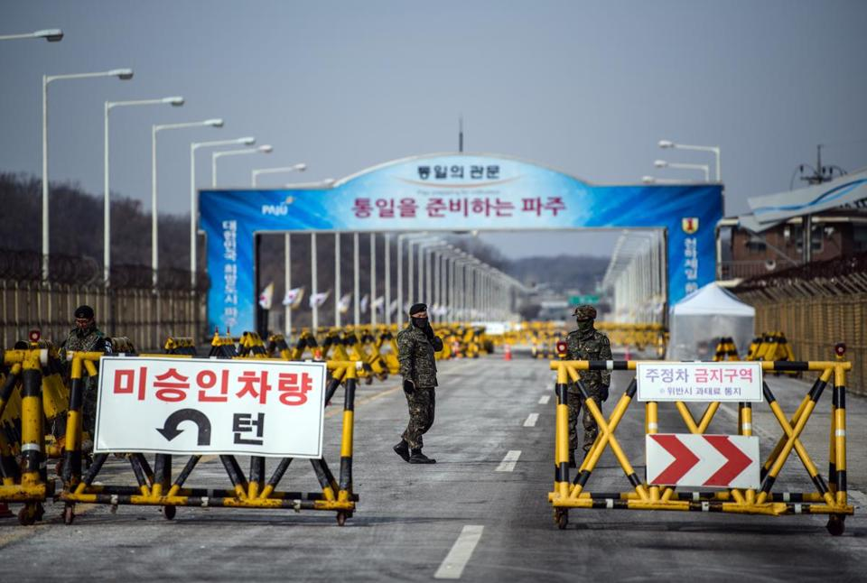PANMUNJOM, SOUTH KOREA - FEBRUARY 07: South Korean soldiers patrol the road connecting South and North Korea at the Unification Bridge near the Demilitarized Zone (DMZ) on February 7, 2018 near Panmunjom, South Korea. In a sign of thawing bilateral ties, North Korea today announced that Kim Yo-jong, the sister of North Korean leader, Kim Jong-un, will attend Friday's opening ceremony of the PyeongChang Winter Olympic Games. (Photo by Carl Court/Getty Images)