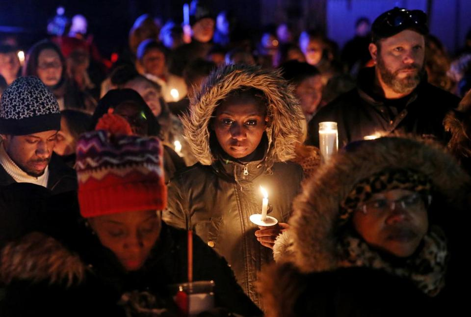 Community members gathered for a vigil in memory of 8-year-old Edson Brito and 5-year-old Lason Brito outside their home in Brockton on Thursday.