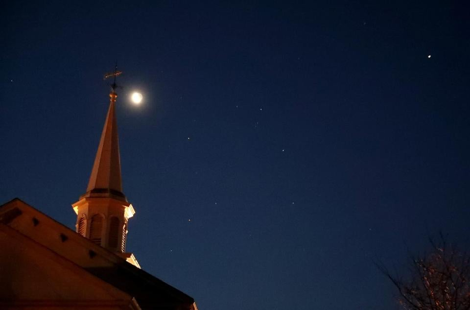 The First Congregational Church in Hanover under the moon, planets, and stars before sunrise looking south.