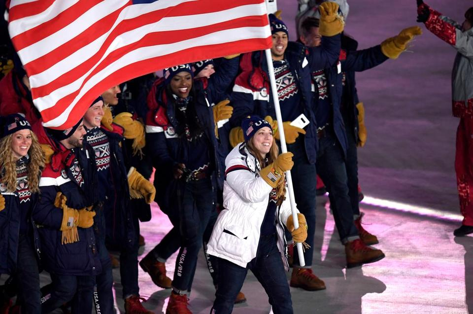 Mandatory Credit: Photo by DANIEL KOPATSCH/EPA-EFE/REX/Shutterstock (9366864ek) US flag bearer Erin Hamlin leads the US team into the stadium during the Opening Ceremony of the PyeongChang 2018 Olympic Games at the Olympic Stadium, Pyeongchang county, South Korea, 09 February 2018. Opening Ceremony - PyeongChang 2018 Olympic Games, Daegwallyeong-Myeon, Korea - 09 Feb 2018