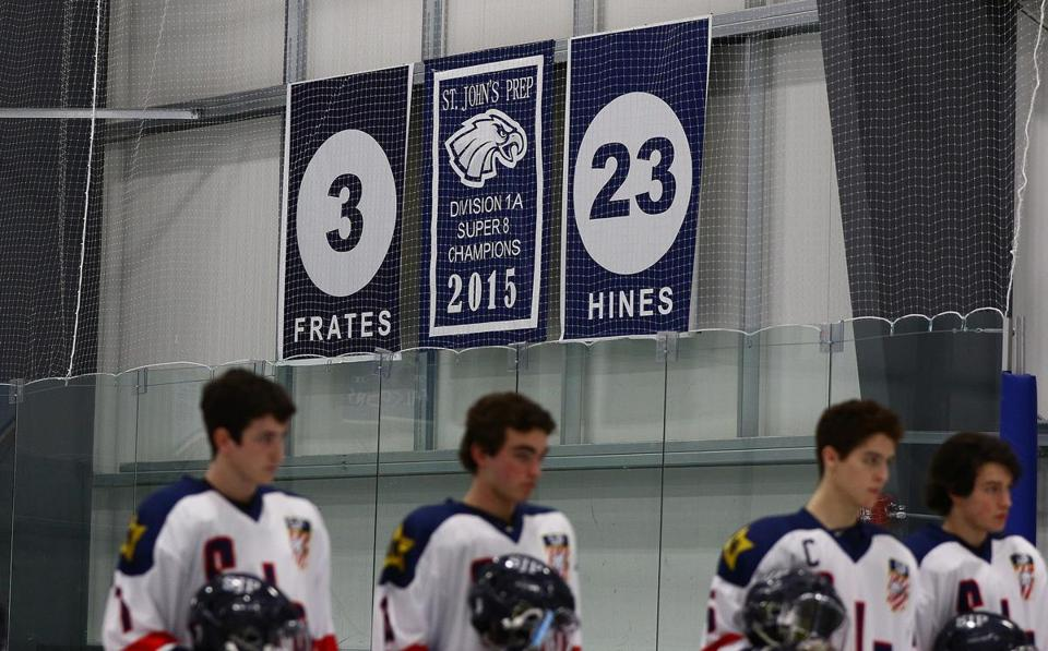 St. John's Prep hockey players, before the start of their game against Newburyport, showing the retired number of 1st Lt. Derek Hines , the school retired his jersey prior to the start of the game. Saturday, February 10, 2018. Mark Lorenz for the Boston Globe.