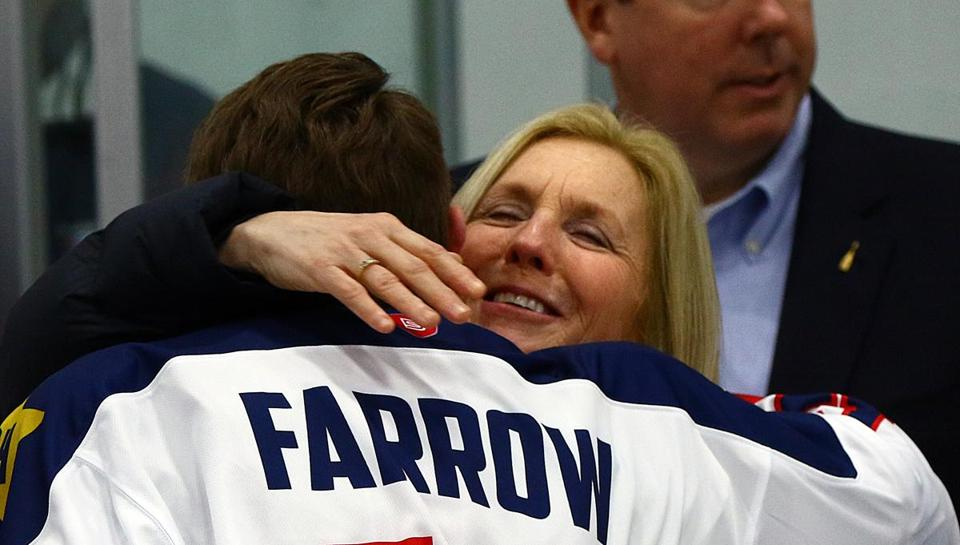 St. John's Prep captain Ryan Farrow hugs Susan Hines, during a ceremony in honor of her son, Prep graduate, 1st Lt. Derek Hines as they retired his No. 23 hockey jersey and dedicate a bronze and granite memorial, which will be installed in his honor on the Prep campus, Saturday, February 10, 2018. Mark Lorenz for the Boston Globe.