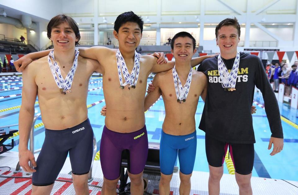 The swimmers for Needham's 400-yard freestyle relay —(left to right) Sergey Sonkin, Eric Zhu, Zibing Zhang  and Henry Keegan — clinched the South Sectional title for the Rockets.