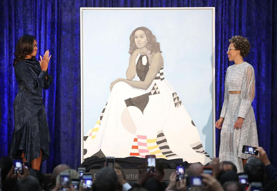 Michelle Obama (left) with artist Amy Sherald.