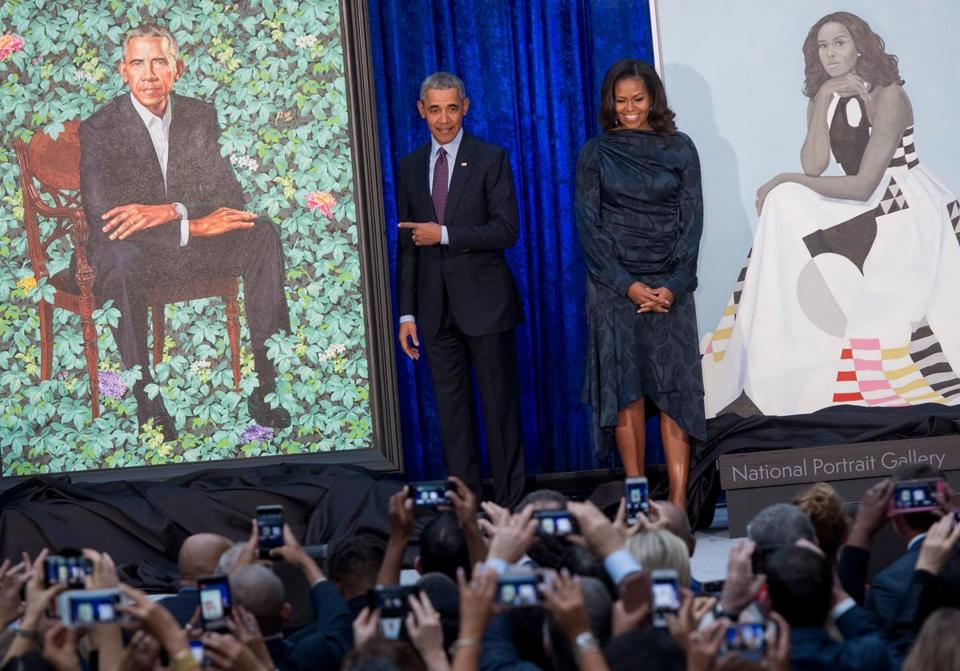 Barack and Michelle Obama helped unveil their portraits at the Smithsonian's National Portrait Gallery in Washington on Monday.