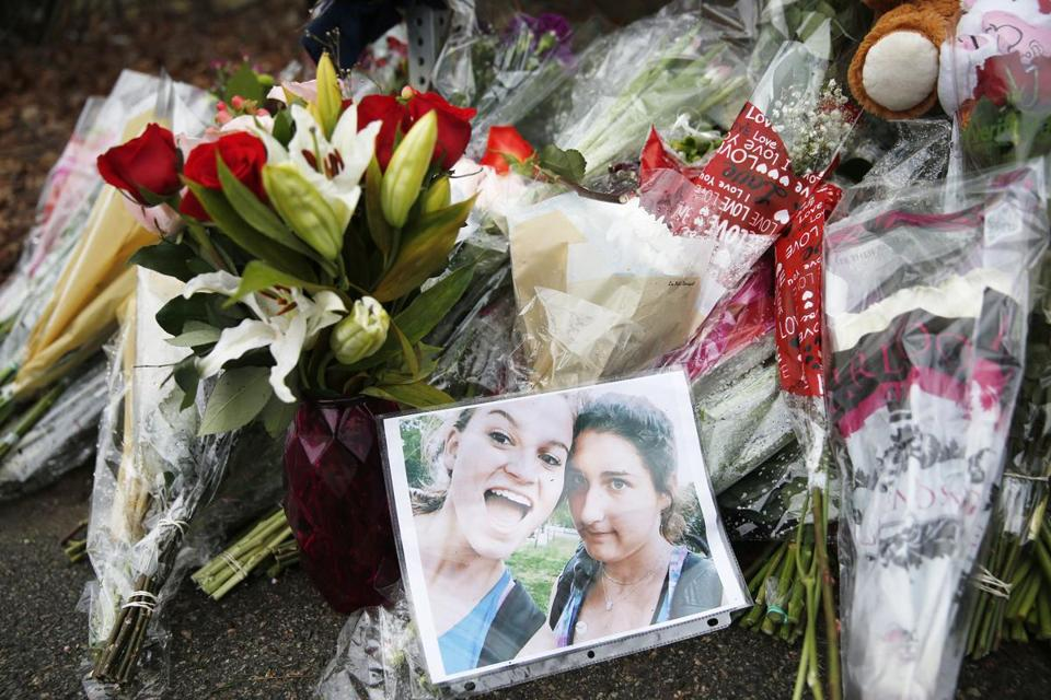 A photograph rested against bouquets left at a makeshift memorial for two Needham High School students, Talia Newfield and Adrienne Garrido.