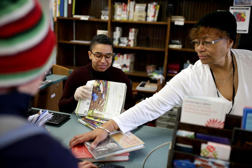 Librarian assistants Isabel Monteiro (left) and Denise Campbell worked at the current library branch.