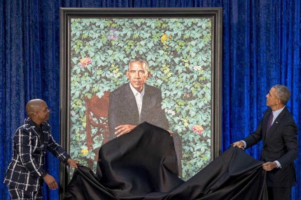 Former President Barack Obama (right) and Artist Kehinde Wiley unveiled Obama's official portrait at the Smithsonian's National Portrait Gallery.