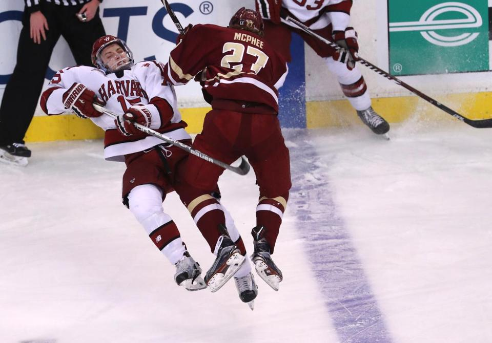 BC's Graham McPhee goes airborne to check Harvard's Seb Lloyd during the first period Monday.