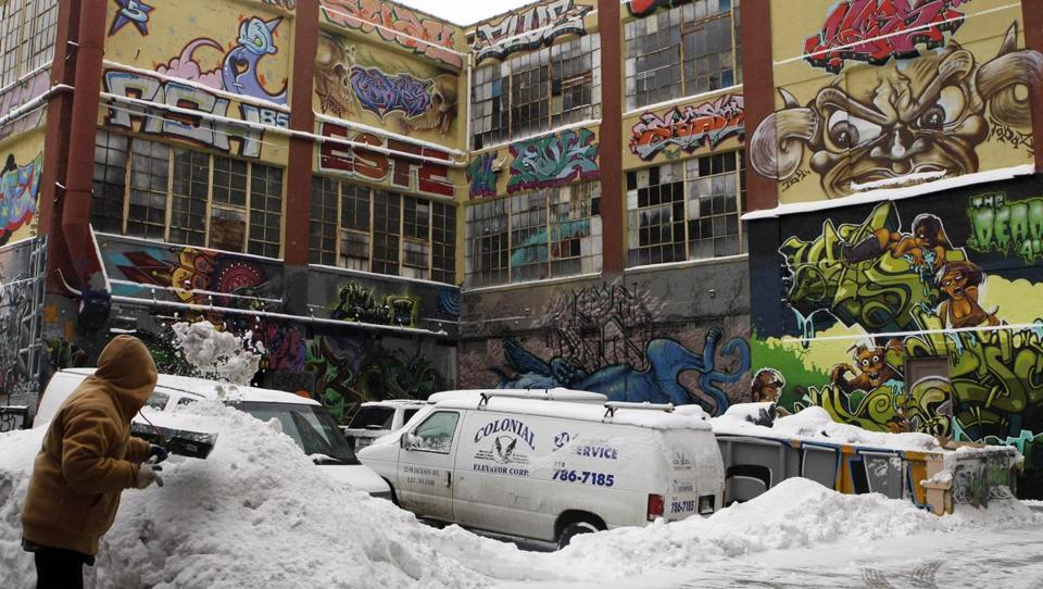 A man shoveled snow near 5Pointz, a graffiti art gallery in New York that was destroyed several years ago.