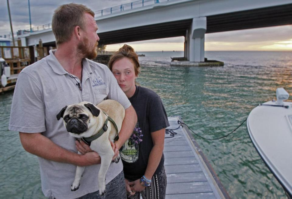 Tanner Broadwell held his dog with Nikki Walsh at Madeira Beach, Fla.