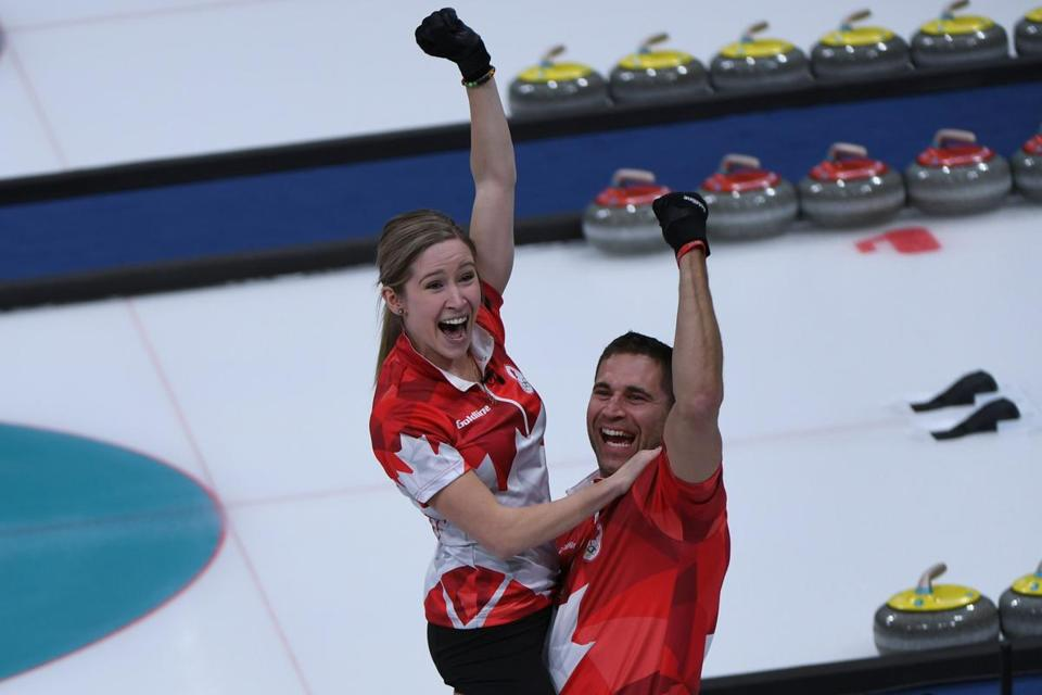 Canada's Kaitlyn Lawes and John Morris celebrate after winning the curling mixed doubles gold medal game during the Pyeongchang 2018 Winter Olympic Games at the Gangneung Curling Centre in Gangneung on February 13, 2018. / AFP PHOTO / WANG ZhaoWANG ZHAO/AFP/Getty Images