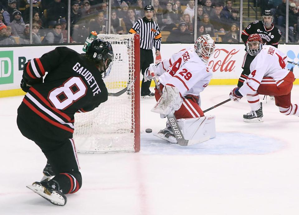 Beanpot MVP Adam Gaudette (8) beats BU goalie Jake Oettinger (29) with a harsh-angle shot that ricocheted off the netminder's skate and into the net during the second period of NU's 5-2 win Monday night in the Beanpot final.