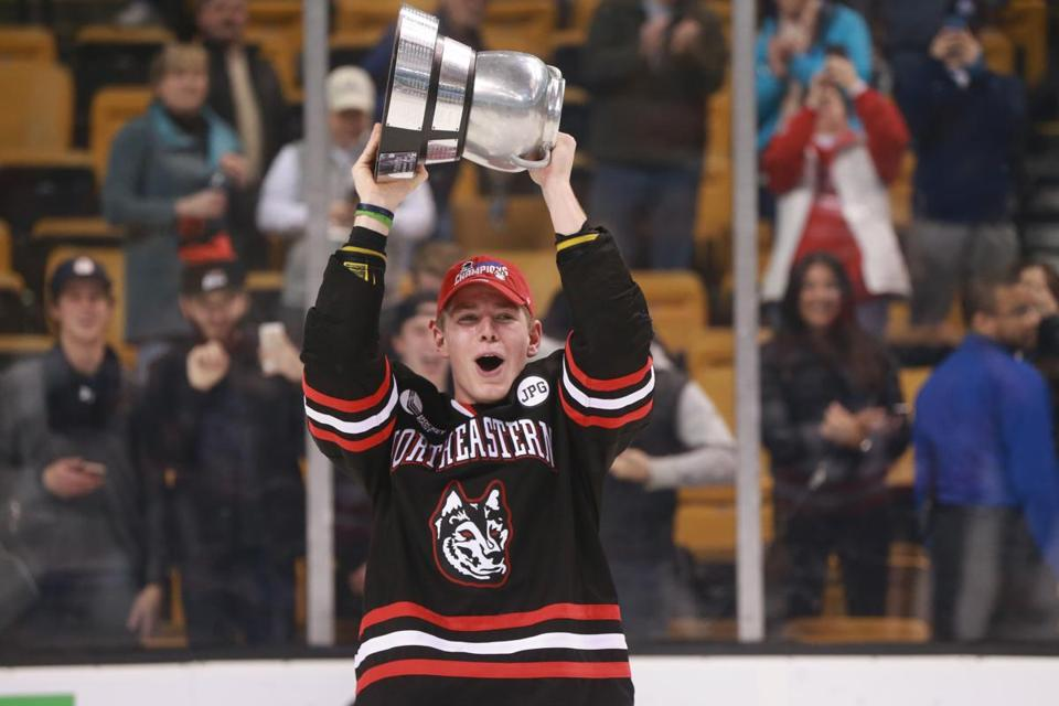 Boston MA 02/12/18 Northeastern University Matt Filipe holding up the Beanpot trophy after they defeated Boston University 5-2 in the Beanpot Championship game at the TD Garden. (Matthew J. Lee/Globe staff) topic: reporter: