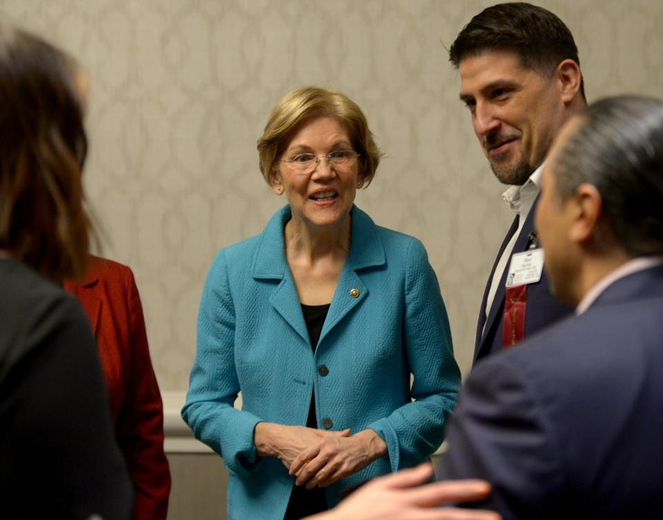 Senator Elizabeth Warren greeted people behind stage before speaking on Wednesday at the Congress of American Indians in Washington, D.C.