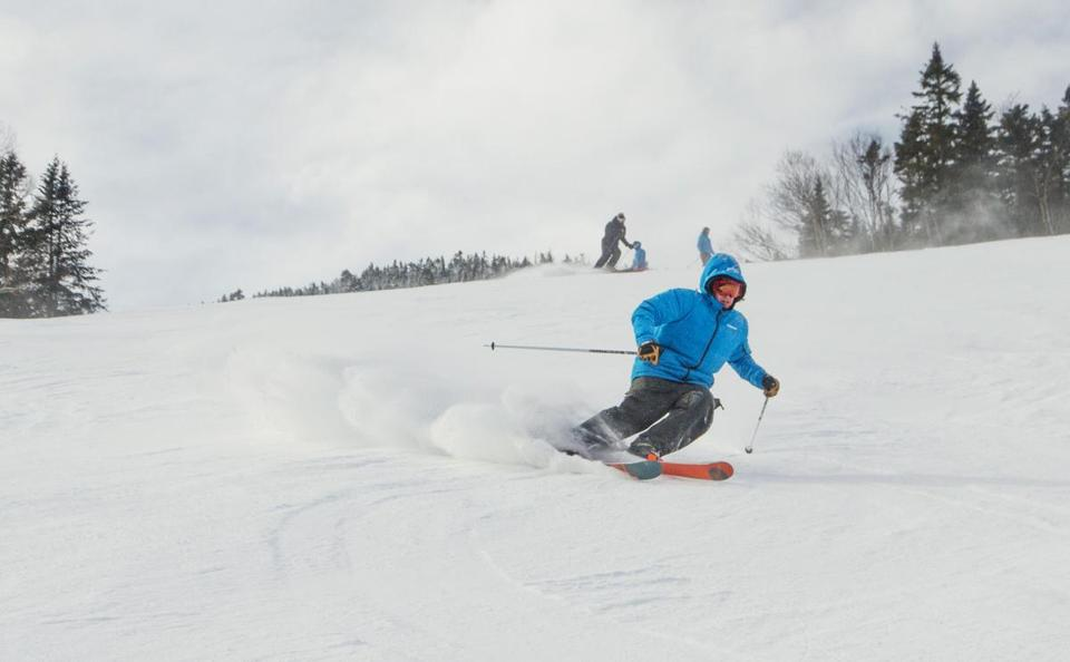 In this February 2017 photo provided by the Olympic Regional Development Authority, or ORDA/Whiteface Lake Placid, a man skis on the snowy slopes of Whiteface Mountain, in Lake Placid, N.Y. The mountain, which has hosted Winter Olympic games in the past, has undergone several upgrades since last season. (Brandee Reilly/ORDA/Whiteface Lake Placid via AP)