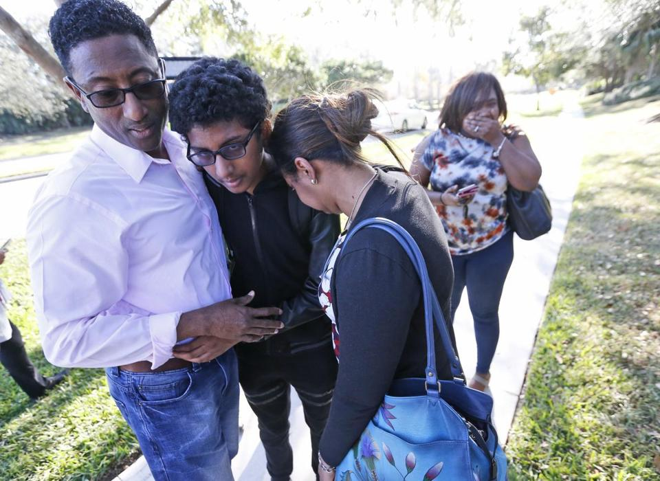 Family members embraced after a student walked out from Marjory Stoneman Douglas High School.