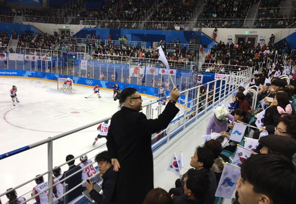 A Kim Jong-un impersonator, calling himself only Howard from Australia, waved a unification flag at the Korea-Japan women's ice hockey game Wednesday.
