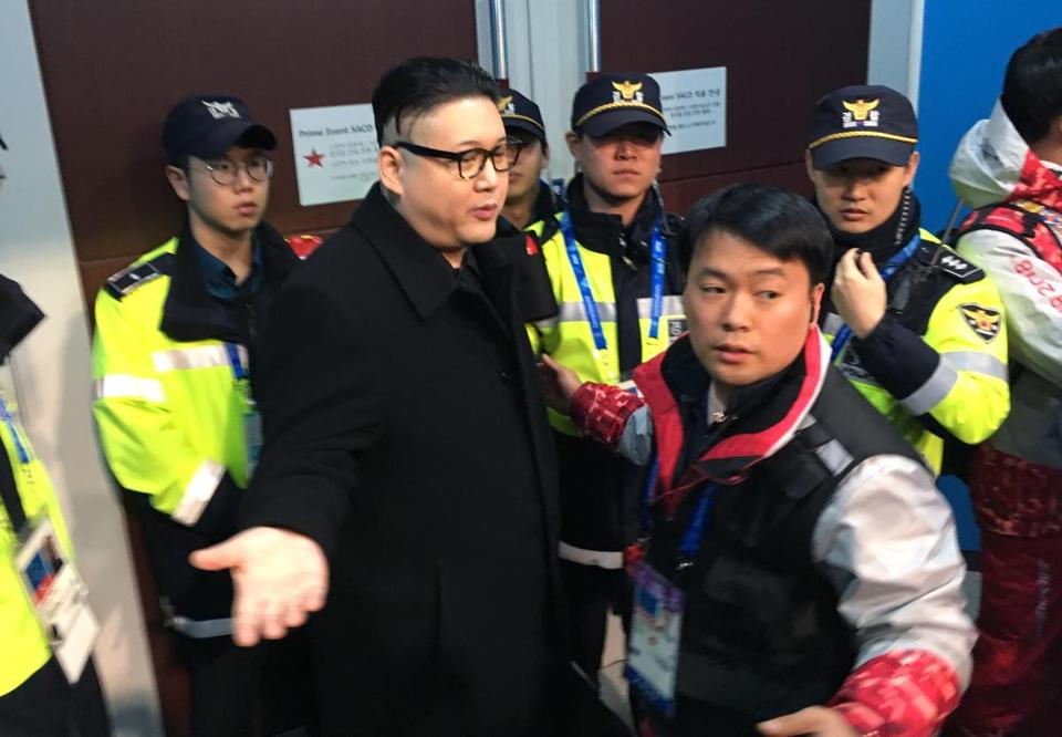 Police officers surrounded Howard from Australia at a women's ice hockey game between Japan and the combined Koreas.