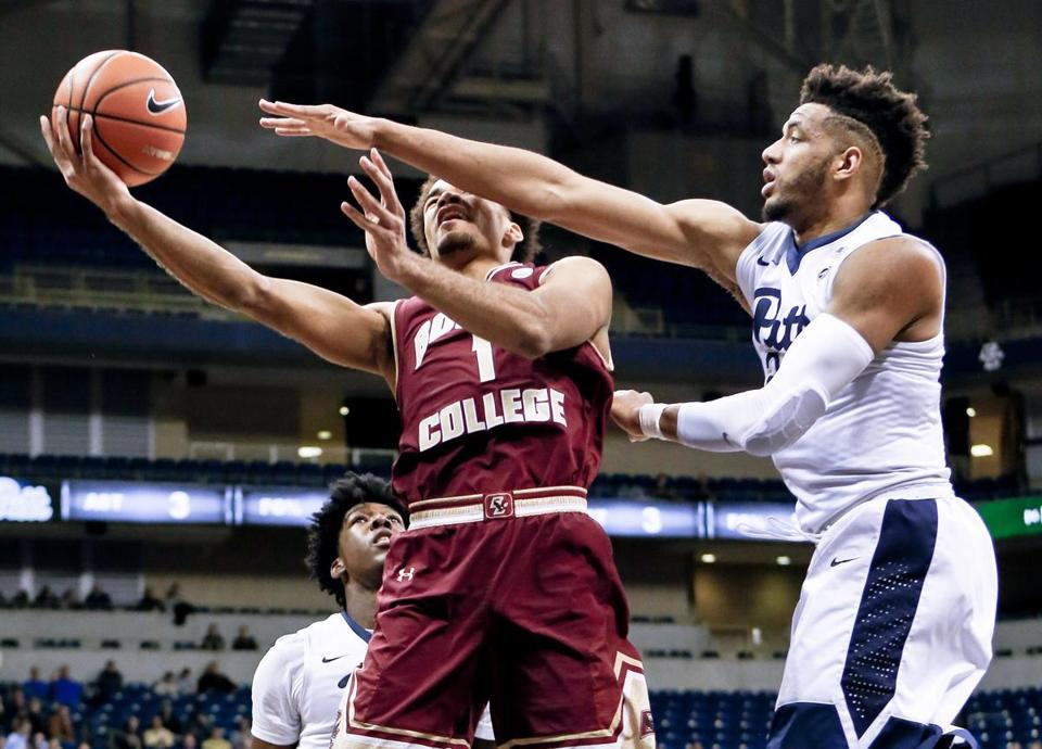 Boston College's Jerome Robinson (1) avoided the long arm of Pitt's 's Terrell Brown to get a shot off in the first half.