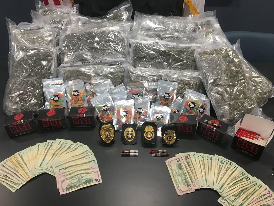 Four men were arrested in Danvers on Thursday after police seized $137,000 and numerous narcotics.