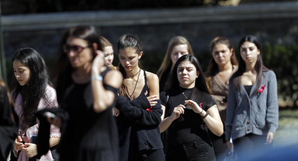 Mourners leave the funeral of Meadow Pollack, a victim of the Wednesday shooting at Marjory Stoneman Douglas High School, in Parkland, Fla., Friday, Feb. 16, 2018. Nikolas Cruz, a former student, was charged with 17 counts of premeditated murder on Thursday. (AP Photo/Gerald Herbert)