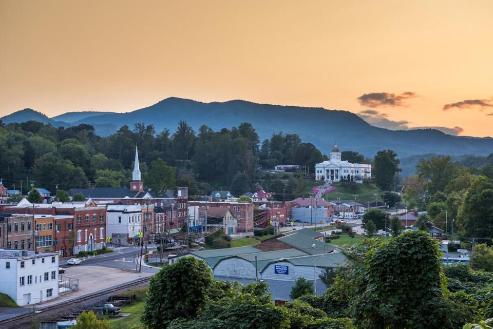 Sylva's downtown, against the backdrop of the surrounding Blue Ridge Mountains at dusk.