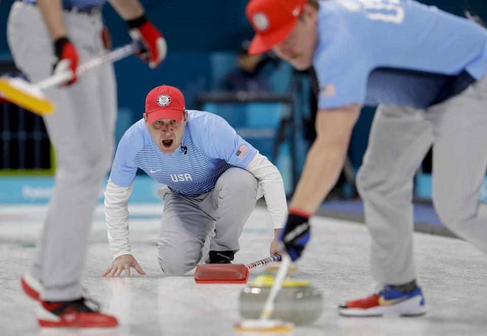John Shuster (rear) throws a rock for the United States squad in the semifinals.