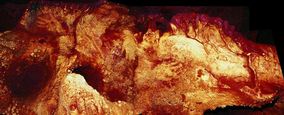 Three hand stencils found in Maltravieso Cave. One has been dated to at least 66,000 years ago and must have been made by a Neanderthal, researchers say.