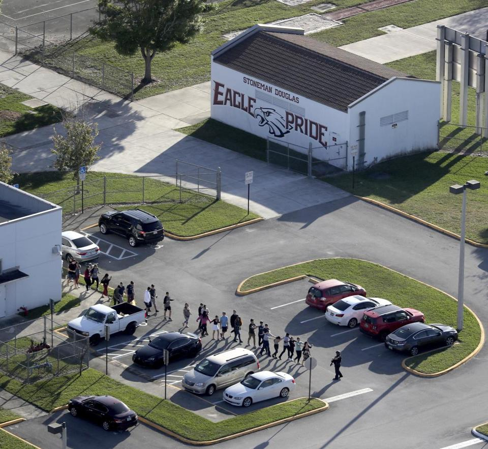 Students were evacuated by police from Marjory Stoneman Douglas High School in Parkland, Fla., after a shooter opened fire on the campus.