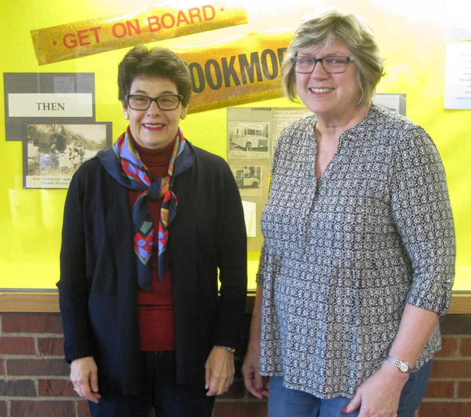 Ruth Winett (left), president of the Framingham Public Library Foundation and library trustee, with Jo-Anne Thompson, a foundation member and library trustee who chaired the last annual appeal that raised money for the bookmobile project.