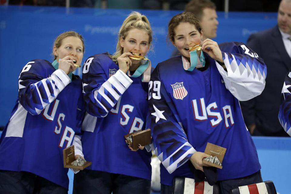 Untied States hockey team celebrate with their gold medals after beating Canada in the women's gold medal hockey game at the 2018 Winter Olympics in Gangneung, South Korea, Thursday, Feb. 22, 2018. (AP Photo/Julio Cortez)