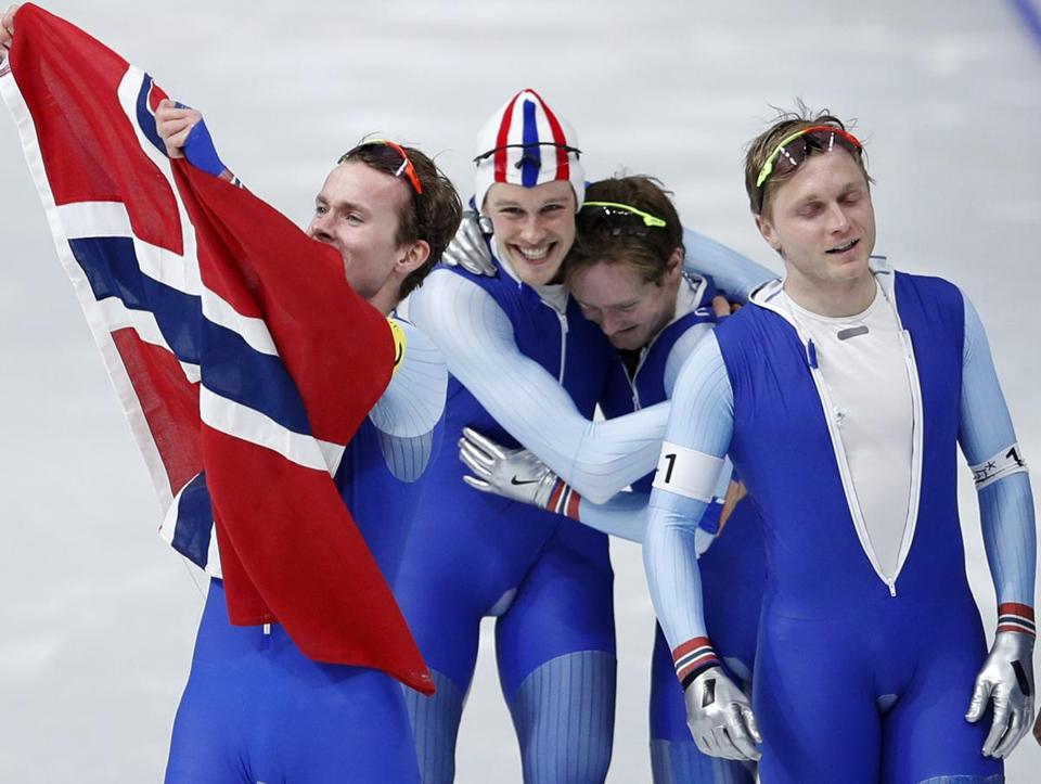 The men's speedskating team from Norway celebrates after winning the gold in the 2018 Winter Olympics.