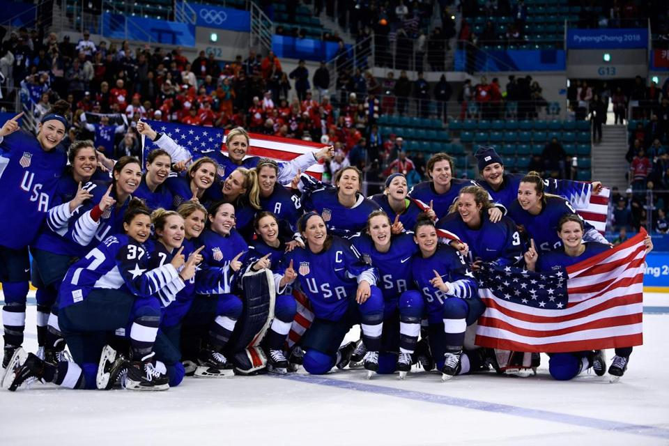 The US team celebrates winning the women's gold medal ice hockey match between the US and Canada during the Pyeongchang 2018 Winter Olympic Games at the Gangneung Hockey Centre in Gangneung on February 22, 2018. / AFP PHOTO / Brendan SmialowskiBRENDAN SMIALOWSKI/AFP/Getty Images
