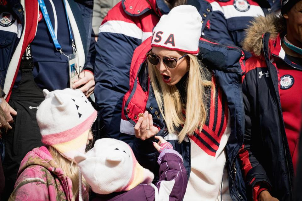 PYEONGCHANG-GUN, SOUTH KOREA - FEBRUARY 25: A child is given a chocolate to Ivanka Trump as she attends the 4-man Boblseigh on day sixteen of the PyeongChang 2018 Winter Olympic Games at Olympic Sliding Centre on February 25, 2018 in Pyeongchang-gun, South Korea. Ivanka Trump is on a four-day visit to South Korea to attend the closing ceremony of the PyeongChang Winter Olympics. (Photo by Andreas Rentz/Getty Images)