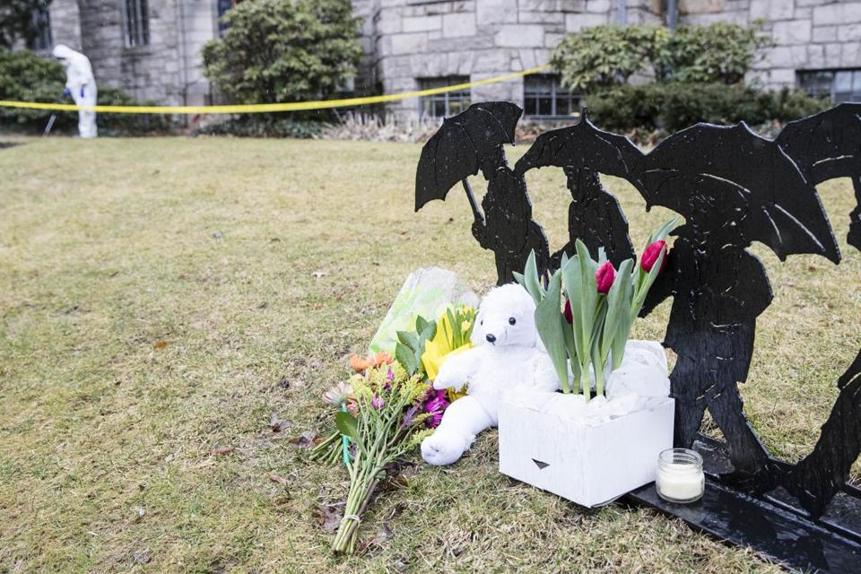 A memorial was outside the Winchester Public Library after the stabbing death Deane Stryker Saturday.