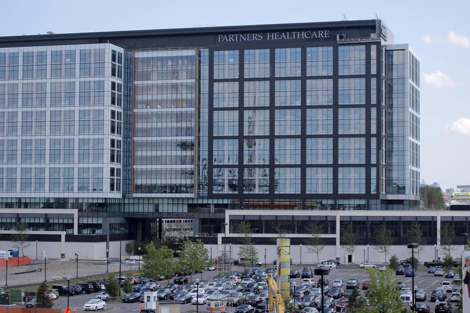 Partners HealthCare is in merger talks with two Rhode Island health care networks.