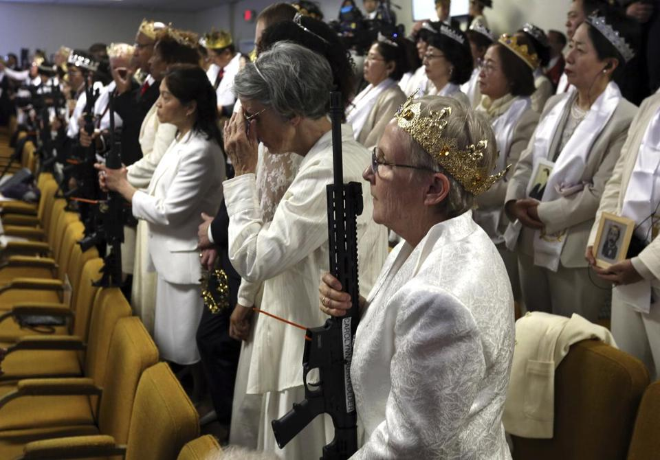 A woman held an unloaded weapon during services at the World Peace and Unification Sanctuary on Wednesday in Newfoundland, Pa.