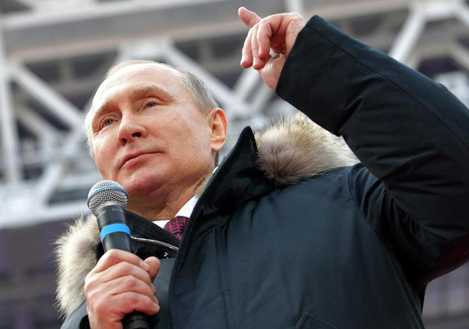 Putin Says He Will 'Never' Extradite Russians Charged By Mueller