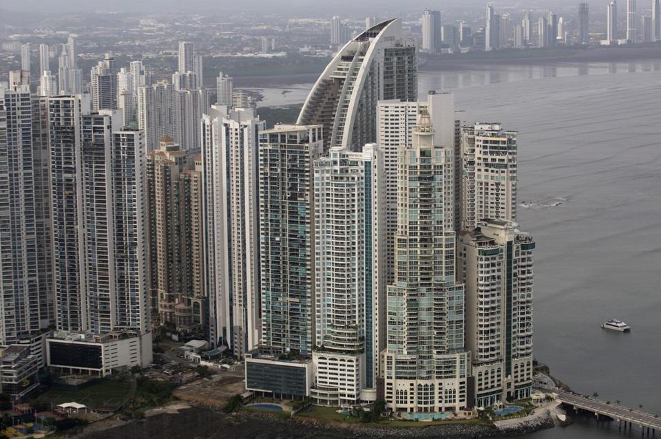 The hotel (the building with the curved roof) is a prominent part of the Panama City skyline.