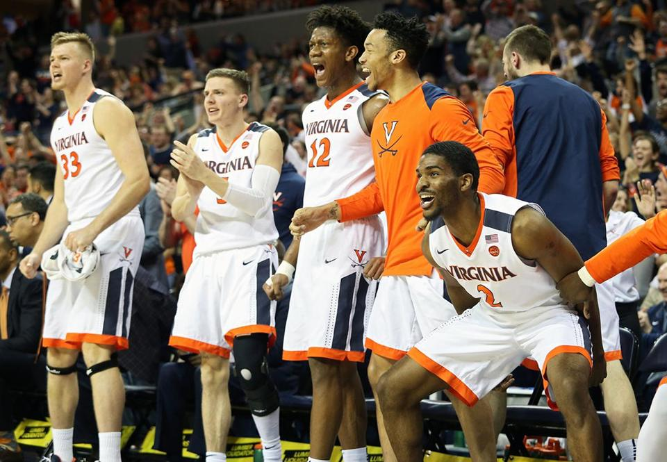 CHARLOTTESVILLE, VA - MARCH 3: Justice Bartley #2 of the Virginia Cavaliers and the rest of the bench cheers in the second half during a game against the Notre Dame Fighting Irish at John Paul Jones Arena on March 3, 2018 in Charlottesville, Virginia. Virginia defeated Notre Dame 62-57. (Photo by Ryan M. Kelly/Getty Images)
