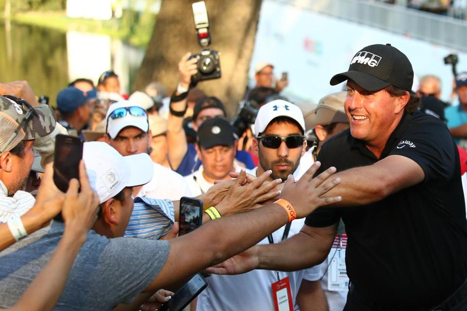 MEXICO CITY, MEXICO - MARCH 04: Phil Mickelson greets fans after winning the final round of World Golf Championships-Mexico Championship on a playoff hole against Justin Thomas (not in frame) at Club De Golf Chapultepec on March 4, 2018 in Mexico City, Mexico. (Photo by Gregory Shamus/Getty Images)